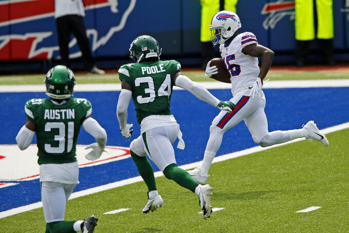 Buffalo Bills wide receiver John Brown, right, scores after taking a pass from quarterback Josh Allen during the first half of an NFL football game against the New York Jets in Orchard Park, N.Y., Sunday, Sept. 13, 2020. (AP Photo/Jeffrey T. Barnes)