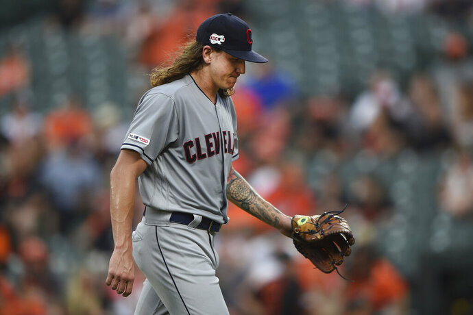 FILE - In this June 28, 2019, file photo, Cleveland Indians pitcher Mike Clevinger walks to the dugout after giving up four runs to the Baltimore Orioles in the first inning of a baseball game, in Baltimore. The Indians made one stirring comeback after another through a season littered with adversity, misfortune and unexpected challenges. Their last one fell short. For the first time since 2015, baseball's postseason will go on without them. (AP Photo/Gail Burton, File)