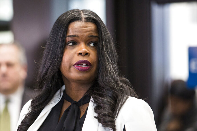 FILE- In this Feb. 23, 2019, file photo, Cook County State's Attorney Kim Foxx speaks to reporters at the Leighton Criminal Courthouse after R. Kelly was ordered held on a $1 million bond, in Chicago. The Chicago police union's president alleges that the county's top prosecutor interfered with the probe of