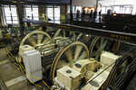 People stand above turning sheaves and gearboxes inside the cable car powerhouse Wednesday, Sept. 11, 2019, in San Francisco. San Francisco's iconic cable cars will stop running for 10 days starting Friday to undergo repairs. The city's transit agency says it needs to get the manually operated cable cars off the street to rehabilitate the gearboxes that power the system that started in the 1890s. Shuttle buses will instead transport people along the steep streets of the cable car routes. (AP Photo/Eric Risberg)