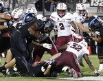 Central Florida running back Taj McGowan, front left, runs past the Temple defense for a 1-yard touchdown during the first half of an NCAA college football game Thursday, Nov. 1, 2018, in Orlando, Fla. (AP Photo/John Raoux)