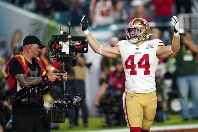 San Francisco 49ers' Kyle Juszczyk celebrates his touchdown against the Kansas City Chiefs during the first half of the NFL Super Bowl 54 football game Sunday, Feb. 2, 2020, in Miami Gardens, Fla. (AP Photo/David J. Phillip)