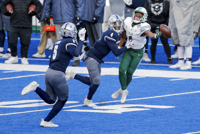 Tulane wide receiver Jha'Quan Jackson (4) reaches for the ball as he is hit early by Nevada defensive back EJ Muhammad (4) during the second half of the Idaho Potato Bowl NCAA college football game, Tuesday, Dec. 22, 2020, in Boise, Idaho. Muhammad was called for interference. Nevada won 38-27 (AP Photo/Steve Conner)
