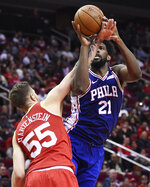 Philadelphia 76ers center Joel Embiid (21) is fouled by Houston Rockets center Isaiah Hartenstein during the second half of an NBA basketball game Friday, Jan. 3, 2020, in Houston. (AP Photo/Eric Christian Smith)