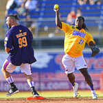 Cleveland Browns running back Kareem Hunt throws to first after forcing out professional wrestler Michael Wardlow during the Jarvis Landry Celebrity Softball game Saturday, June 12, 2021 in Eastlake, Ohio. (AP Photo/David Dermer)