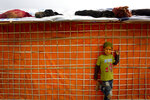 A Rohingya boy leans against the wall of a make shift shelter at Nayapara refugee camp, some 69 kilometres (43 miles) from in Cox bazar, Bangladesh, Saturday, Jan. 13, 2018. In Rakhine state of Myanmar, government troops have been accused of