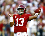 Alabama quarterback Tua Tagovailoa (13) throws a pass during the first half of the team's NCAA college football game against Missouri, Saturday, Oct. 13, 2018, in Tuscaloosa, Ala. (AP Photo/Butch Dill)