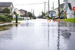 Rain from Tropical Storm Fay floods a street in Ventnor, N.J., Friday, July 10, 2020. The fast-moving tropical storm made landfall in New Jersey on Friday amid heavy, lashing rains that closed beaches and flooded shore town streets. (Kristian Gonyea/The Press of Atlantic City via AP)