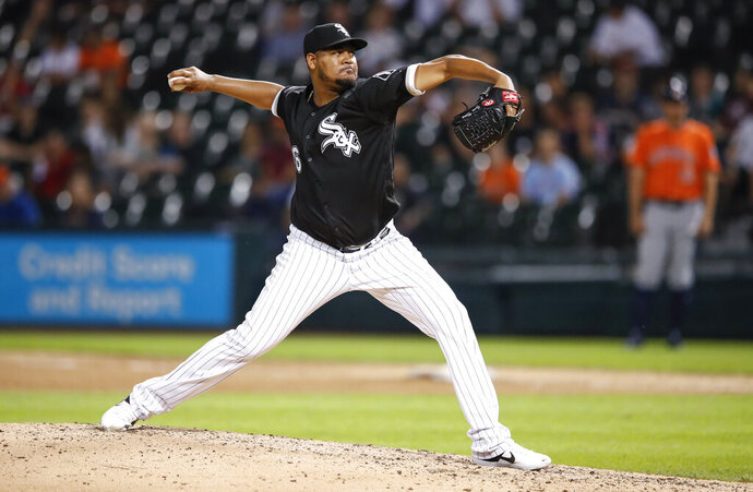 Chicago White Sox starting pitcher Ivan Nova delivers against the Houston Astros during the ninth inning of the second baseball game of a doubleheader Tuesday, Aug. 13, 2019, in Chicago. (AP Photo/Kamil Krzaczynski)
