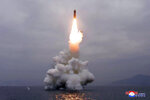 FILE - In this Oct. 2, 2019, file photo provided Oct. 3, 2019, by the North Korean government, an underwater-launched missile lifts off in the waters off North Korea's eastern coastal town of Wonsan. North Korean leader Kim Jong Un's threat to show the world a new strategic weapon and possibly resume long-range missile tests is another dramatic turn in his high-stakes summitry with President Donald Trump. Korean language watermark on image as provided by source reads: