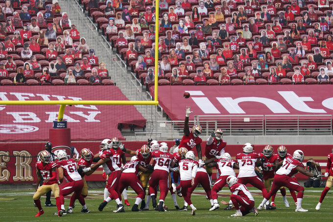 Cutouts are seated at Levi's Stadium as Arizona Cardinals kicker Zane Gonzalez (5) kicks a point after try during the first half of an NFL football game against the San Francisco 49ers in Santa Clara, Calif., Sunday, Sept. 13, 2020. (AP Photo/Tony Avelar)