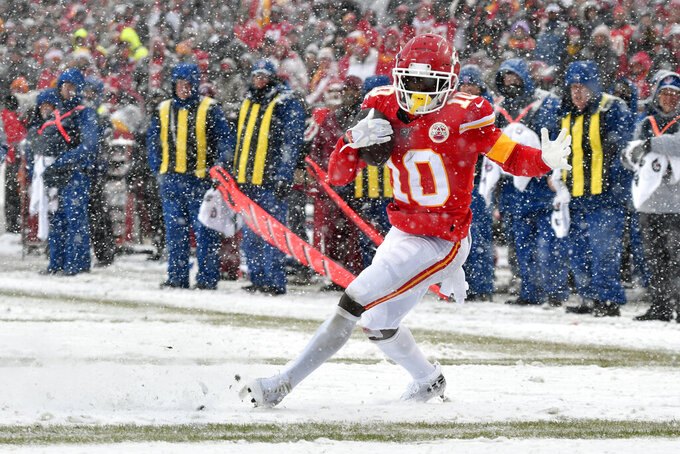Kansas City Chiefs wide receiver Tyreek Hill (10) runs for a touchdown during the second half of an NFL football game against the Denver Broncos in Kansas City, Mo., Sunday, Dec. 15, 2019. (AP Photo/Ed Zurga)