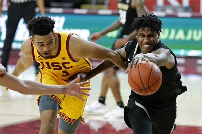 Colorado's Jabari Walker, right, and Southern California's Isaiah Mobley go after a loose ball during the second half of an NCAA college basketball game Thursday, Dec. 31, 2020, in Los Angeles. Colorado won 72-62. (AP Photo/Jae C. Hong)