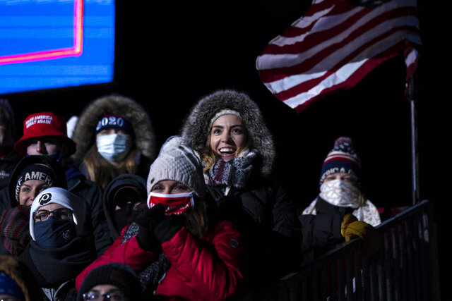 Supporters listen as President Donald Trump speaks at a campaign rally at Eppley Airfield, Tuesday, Oct. 27, 2020, in Omaha, Neb. (AP Photo/Evan Vucci)