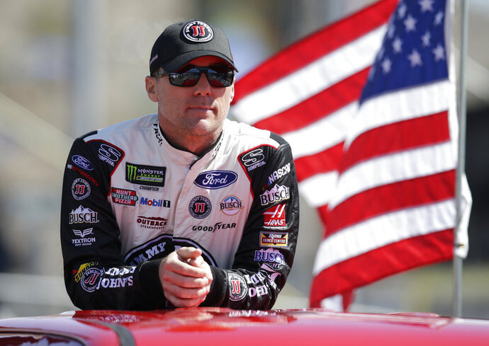 Kevin Harvick (4) stands during a parade lap before a NASCAR Cup Series auto race on Sunday, March 11, 2018, in Avondale, Ariz. (AP Photo/Rick Scuteri)