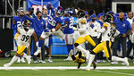 New York Giants running back Saquon Barkley (26) leaps to avoid being tackled by the Pittsburgh Steelers during the second quarter of an NFL football game Monday, Sept. 14, 2020, in East Rutherford, N.J. (AP Photo/Seth Wenig)
