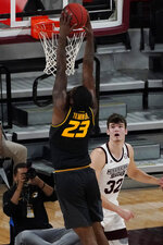 Mississippi State forward Quinten Post (32) watches as Missouri forward Jeremiah Tilmon (23) dunks during the first half of an NCAA college basketball game Tuesday, Jan. 5, 2021, in Starkville, Miss. (AP Photo/Rogelio V. Solis)