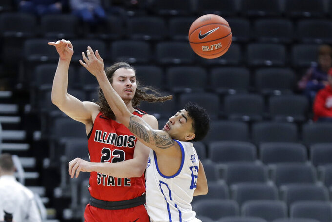 Illinois State's Matt Chastain, left, passes around Drake's Roman Penn during the first half of an NCAA college basketball game in the first round of the Missouri Valley Conference men's tournament Thursday, March 5, 2020, in St. Louis. (AP Photo/Jeff Roberson)
