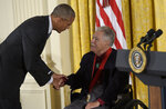 FILE - In this Sept. 22, 2016, file photo, President Barack Obama shakes hands with author, Rudolfo Anaya, after presenting him with the 2015 National Humanities Medal during a ceremony in the East Room of the White House in Washington. Anaya, 82, who helped launch the 1970s Chicano Literature Movement with his novel