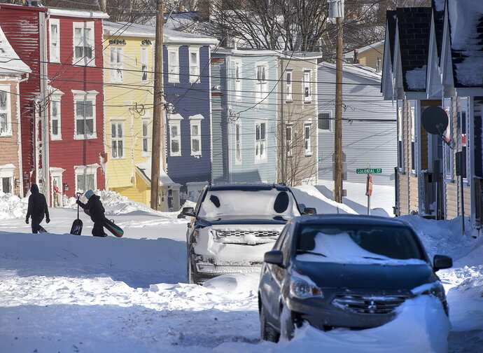 All but the main arteries remain impassable in St. John's, Newfoundland and Labrador, on Saturday, Jan. 18, 2020. The state of emergency ordered by the City of St. John's is still in place, leaving businesses closed and vehicles off the roads in the aftermath of the major winter storm that hit the Newfoundland and Labrador capital. (Andrew Vaughan/The Canadian Press via AP)