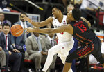 San Diego State's Devin Watson (0) and UNLV's Bryce Hamilton (13) reach for a loose ball during the first half of an NCAA college basketball game in the Mountain West Conference men's tournament Thursday, March 14, 2019, in Las Vegas. (AP Photo/Isaac Brekken)