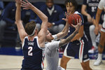 Saint Mary's Logan Johnson (0) drives past Gonzaga Drew Timme (2) during the first half of an NCAA college basketball game in Moraga, Calif., Saturday, Jan. 16, 2021. (Jose Carlos Fajardo/Bay Area News Group via AP)