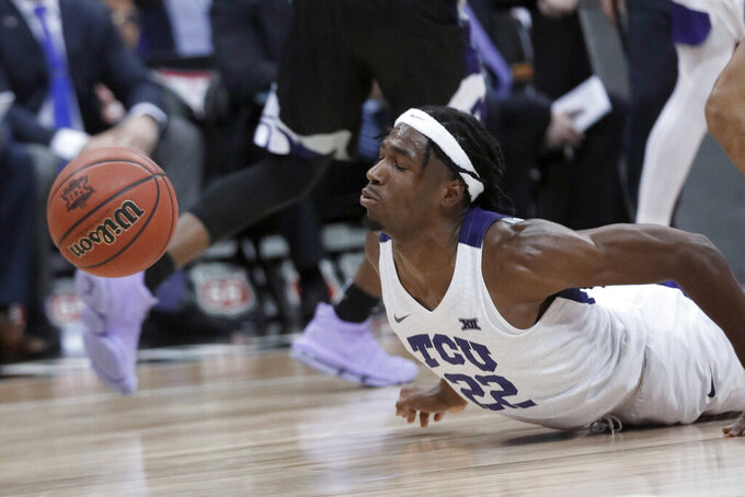 TCU guard RJ Nembhard loses the ball out of bounds during the second half of the team's NCAA college basketball game against Kansas State in the first round of the Big 12 men's tournament in Kansas City, Mo., Wednesday, March 11, 2020. Kansas State won 53-49. (AP Photo/Orlin Wagner)