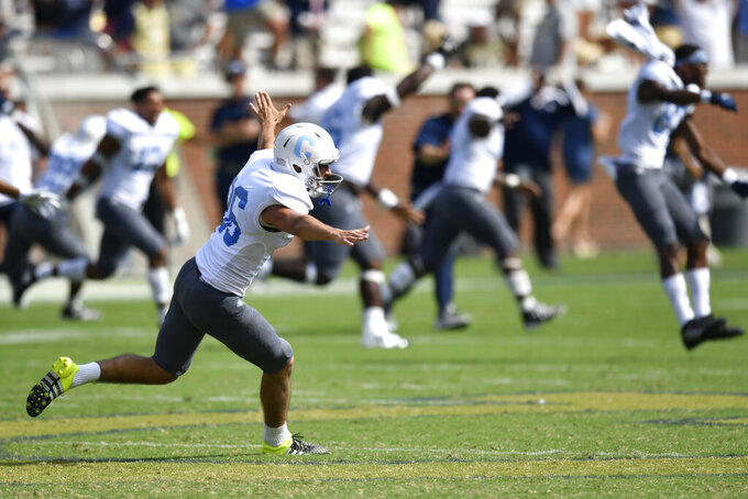 The Citadel place kicker Jacob Godek (86) celebrates hitting the game-winning field goal against Georgia Tech during overtime of an NCAA college football game, Saturday, Sept. 14, 2019, in Atlanta. The Citadel won 27-24. (AP Photo/Mike Stewart)