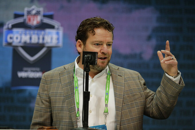 FILE - In this Feb. 25, 2020, file photo, Seattle Seahawks executive vice president and general manager John Schneider speaks during a press conference at the NFL football scouting combine in Indianapolis. The NFL Draft is April 23-25. (AP Photo/Michael Conroy, File)