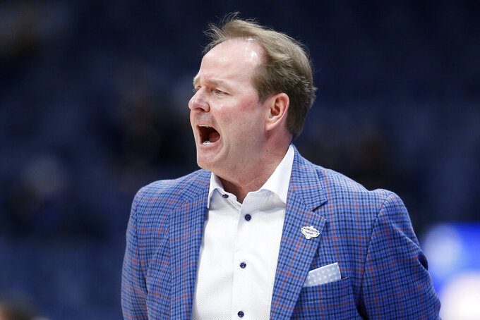 FILE - In this March 11, 2020, file photo, Mississippi head coach Kermit Davis yells to his players in the first half of an NCAA college basketball game against Georgia in the Southeastern Conference Tournament in Nashville, Tenn. Davis has tested positive for COVID-19 and could be sidelined when the season starts. Ole Miss announced the positive test on Tuesday, Nov. 17, 2020, saying if a follow-up test is also positive Davis will isolate at home and miss the Rebels' first two games. (AP Photo/Mark Humphrey, File)