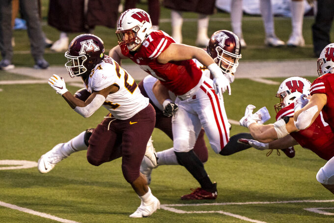 FILE - Wisconsin linebacker Jack Sanborn chases Minnesota running back Mohamed Ibrahim (24) during the first half of an NCAA college football game in Madison, Wisc., in this Saturday, Dec. 19, 2020, file photo. Wisconsin is working to become more dynamic this season. For instance, Sanborn has looked back at what he did last season and seen examples of plays he could have made if he'd gotten a better break or if he'd been more effective at seeing what was coming.(AP Photo/Andy Manis, File)