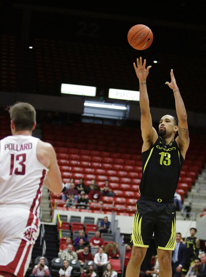Oregon forward Paul White, right, shoots in front of Washington State forward Jeff Pollard during the first half of an NCAA college basketball game in Pullman, Wash., Wednesday, March 6, 2019. (AP Photo/Young Kwak)