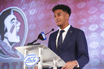 Florida State quarterback Jordan Travis answers a question during an NCAA college football news conference at the Atlantic Coast Conference media days in Charlotte, N.C., Thursday, July 22, 2021. (AP Photo/Nell Redmond)
