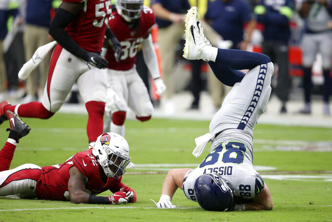 Seattle Seahawks tight end Will Dissly (88) is tackled by Arizona Cardinals strong safety Budda Baker (32) during the first half of an NFL football game, Sunday, Sept. 29, 2019, in Glendale, Ariz. (AP Photo/Ross D. Franklin)