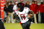 Louisville's Hassan Hall (19) runs the ball against North Carolina State during the first half of an NCAA college football game in Raleigh, N.C., Saturday, Nov. 16, 2019. (AP Photo/Karl B DeBlaker)