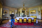 A person walks through a room of the 'Villa la Grange' during a tour for media, in Geneva, Switzerland, on Friday, June 11, 2021. The 'Villa La Grange' is the official venue for the meeting between US President Joe Biden and Russian Presidents Vladimir Poutine in Geneva, scheduled for Wednesday, June 16, 2021. (Martial Trezzini/Keystone via AP)
