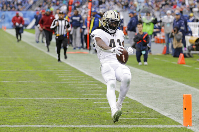 New Orleans Saints running back Alvin Kamara (41) scores a touchdown on a 40-yard run against the Tennessee Titans in the second half of an NFL football game Sunday, Dec. 22, 2019, in Nashville, Tenn. (AP Photo/James Kenney)