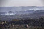 Smoke rises after a fire in La Palma d'Ebre, Spain, Friday June 28, 2019. A major wildfire in northeastern Spain that began in a pile of chicken dung raged out of control for a third straight day Friday with more than 600 firefighters and six water-dropping aircraft battling the blaze in the Catalonia region. Spain is forecast to endure the peak of a recent heat wave, with temperatures expected to exceed 40 degrees Celsius (104 Fahrenheit). (AP Photo/Jordi Borras)