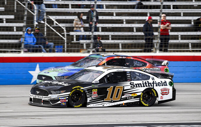 JJ Yeley (53) and Aric Almirola (10) battle for position during a NASCAR Cup Series auto race at Texas Motor Speedway, Sunday, Nov. 3, 2019, in Fort Worth, Texas. (AP Photo/Larry Papke)