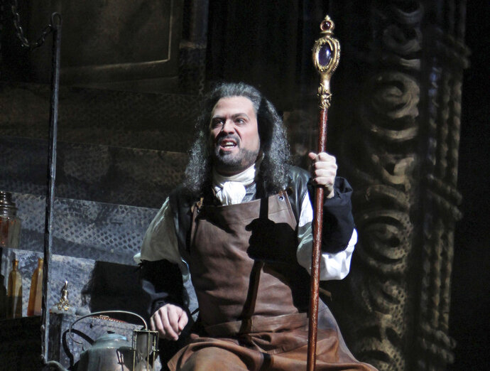 FILE - In this, Dec. 28, 2011 file photo, David Daniels performs as Prospero during the final dress rehearsal of