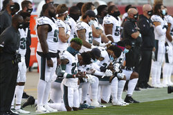 Philadelphia Eagles players kneel during the national anthem before an NFL football game against the San Francisco 49ers in Santa Clara, Calif., Sunday, Oct. 4, 2020. (AP Photo/Jed Jacobsohn)