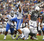 Duke's Drew Jordan, second left, celebrates his sack of Northwestern's Clayton Thorson during the second half of an NCAA college football game Saturday, Sept. 8, 2018, in Evanston, Ill. (AP Photo/Jim Young)