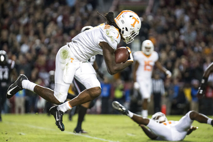 Tennessee wide receiver Marquez Callaway (1) runs with the ball against South Carolina during the first half of an NCAA college football game Saturday, Oct. 27, 2018, in Columbia, S.C. South Carolina defeated Tennessee 27-24. (AP Photo/Sean Rayford)