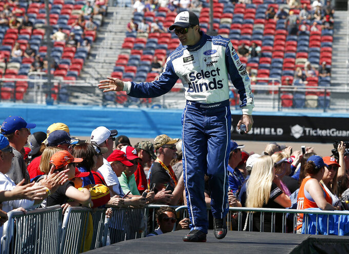 David Ragan is greeted by fans during driver introductions prior to the start of the NASCAR Cup Series auto race at ISM Raceway, Sunday, March 10, 2019, in Avondale, Ariz. (AP Photo/Ralph Freso)