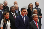 Spain's caretaker Prime Minister Pedro Sanchez, center, stands with Chilean Environment Minister Carolina Schmidt, front left and Antonio Guterres, Secretary-General of the United Nations, front right during a group photograph with the rest of representatives taking part at the COP25 climate talks summit in Madrid, Monday Dec. 2, 2019. The chair of a two-week climate summit attended by nearly 200 countries warned at its opening Monday that those refusing to adjust to the planet's rising temperatures