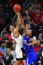 Indiana State center Tre Williams attempts to block the shot of Louisville forward Jordan Nwora (33) during the first half of an NCAA college basketball game in Louisville, Ky., Wednesday, Nov. 13, 2019. (AP Photo/Timothy D. Easley)