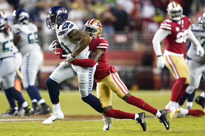 Seattle Seahawks wide receiver Josh Gordon, left, runs against San Francisco 49ers defensive back Emmanuel Moseley during the second half of an NFL football game in Santa Clara, Calif., Monday, Nov. 11, 2019. (AP Photo/Tony Avelar)