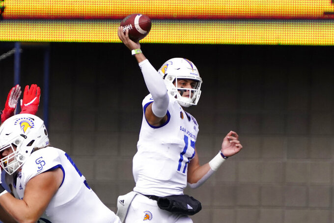 San Jose State quarterback Nick Starkel (17) throws downfield in the first half of the Arizona Bowl NCAA college football game against Ball State, Thursday, Dec. 31, 2020, in Tucson, Ariz. (AP Photo/Rick Scuteri)