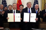 "FILE - In this Wednesday, Jan. 15, 2020, file photo, U.S. President Donald Trump, right, signs a trade agreement with Chinese Vice Premier Liu He, in the East Room of the White House, in Washington. China's government welcomed an interim trade deal with Washington and said Thursday the two sides need to address each other's ""core concerns."" (AP Photo/Evan Vucci, File)"