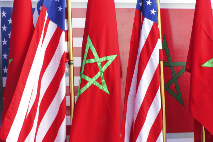 U.S and Moroccan flags stand together on the podium during a visit by David Schenker, US Assistant Secretary of State for Near Eastern Affairs, US Ambassador to Morocco David T. Fischer and Nasser Bourita, Moroccan Foreign Minister, in Dakhla, Morocco-administered Western Sahara, Sunday Jan. 10, 2021. The highest ranking U.S. diplomat for North Africa and the Middle East, as well as the first ever U.S Ambassador, traveled Sunday to the Morocco-administered Western Sahara city of Dakhla, laying the groundwork for the United States to set up a consulate in the disputed territory. (AP Photo/Noureddine Abakchou)